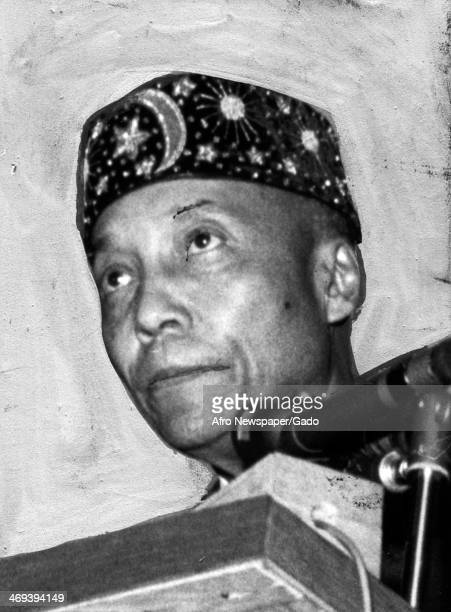 Portrait of Elijah Muhammad leader of Nation of Islam at the podium at a public event 1959