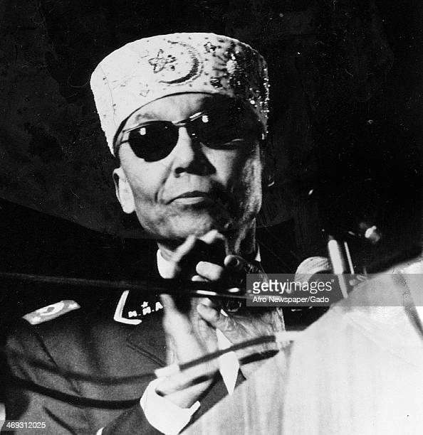 Portrait of Elijah Muhammad leader of Nation of Islam with a microphone 1972