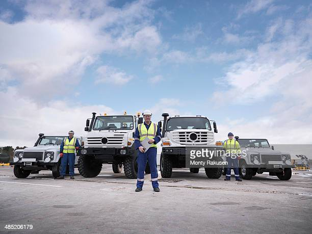 Portrait of Emergency Response Team workers with specialist trucks