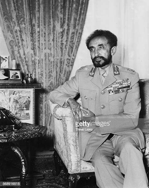 Portrait of Emperor Haile Selassie wearing military uniform sitting in an armchair in the Royal Palace in Addis Abada Ethiopia circa 1960