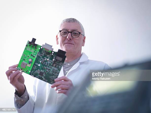 Portrait of engineer designing electronic circuitry for automotive use