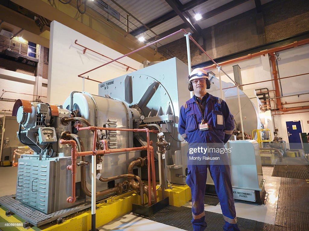 Portrait of engineer in generator room of power station