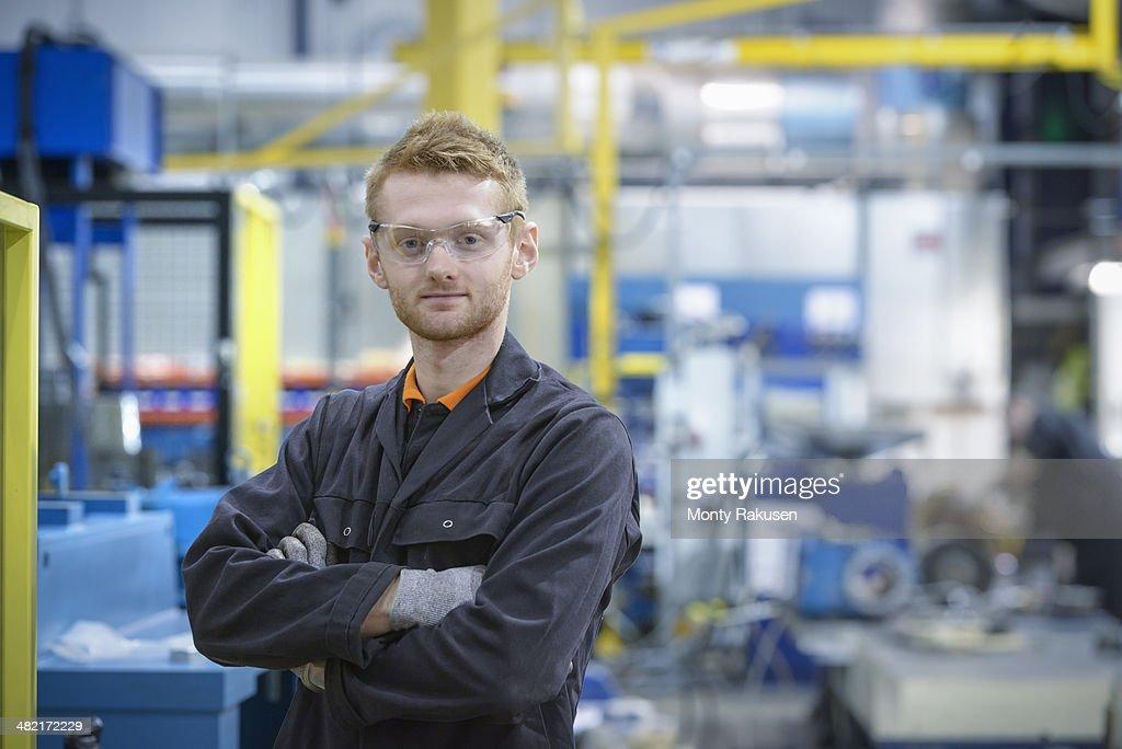 Portrait of engineering apprentice in engineering factory