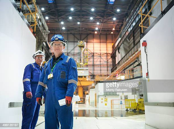 Portrait of engineers in reactor hall in nuclear power station