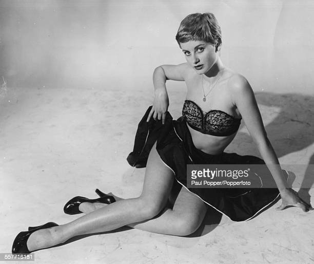 Portrait of English actress Jill Ireland wearing a bra and short skirt on August 19th 1955