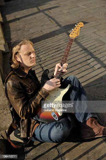 Portrait of English blues guitarist Matt Schofield posing with his 1961 Fender Stratocaster guitar on March 7 2008