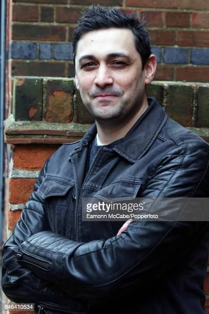 Portrait of English geneticist author and media personality Adam Rutherford as he poses in front of a brick wall at Jubilee Hall during the 16th...