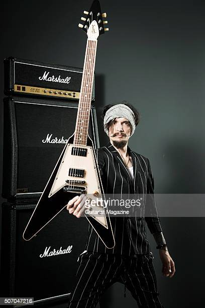 Portrait of English musician Justin Hawkins guitarist and vocalist with rock group The Darkness photographed at Gibson Guitar's UK headquarters in...