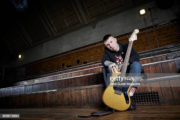 Portrait of English musician Laurie Vincent guitarist with punk rock group Slaves photographed before a live performance at the Albert Hall in...