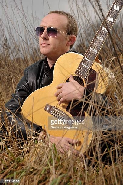 Portrait of English musician Steve Cradock frontman of Ocean Colour Scene posing with his Gibson J185 12string acoustic guitar on January 13 2009