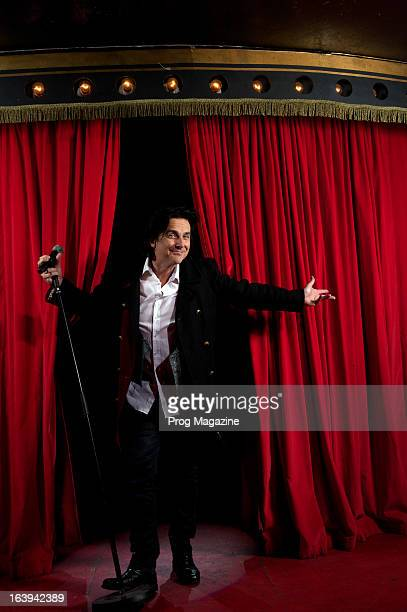 Portrait of English musician Steve Hogarth lead vocalist with British progressive rock group Marillion posing on an oldfashioned burlesque club stage...