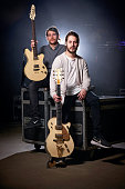 Portrait of English musicians Max Heyler and Chris Miller of hard rock group You Me At Six photographed before a live performance at Manchester Arena...