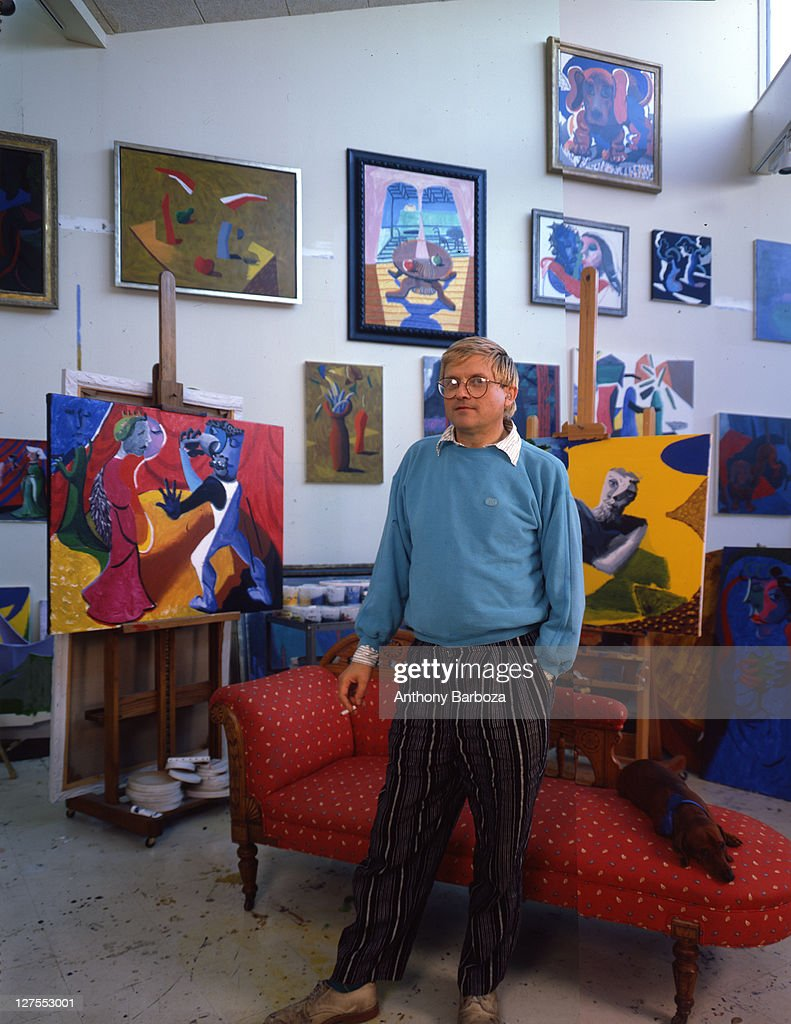 Portrait of English painter <a gi-track='captionPersonalityLinkClicked' href=/galleries/search?phrase=David+Hockney&family=editorial&specificpeople=215305 ng-click='$event.stopPropagation()'>David Hockney</a>, dressed in a light blue sweatshirt and striped trousers, Los Angeles, California, 1980s.