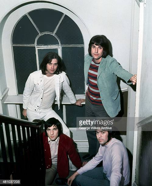 Portrait of English rock band The Kinks as they pose in a stairwell London England 1978 Pictured are brothers Dave Davies and Ray Davies Mick Avory...