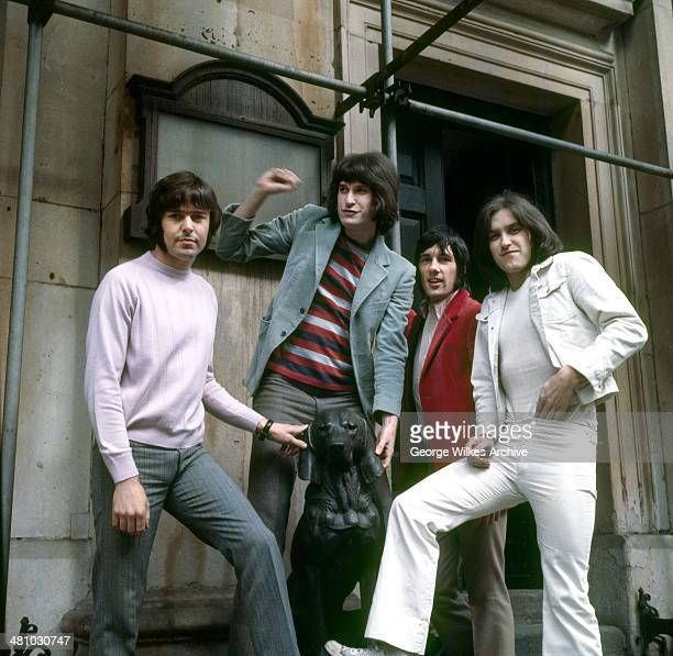Portrait of English rock band The Kinks as they pose under scaffolding London England 1978 Pictured are brothers Ray Davies and Dave Davies Pete...