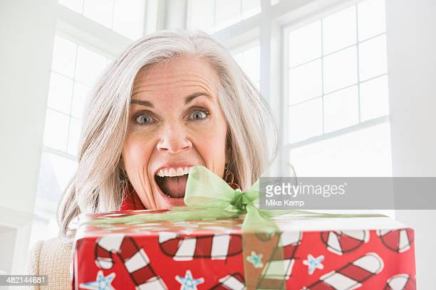 Portrait of enthusiastic Caucasian woman with Christmas gift
