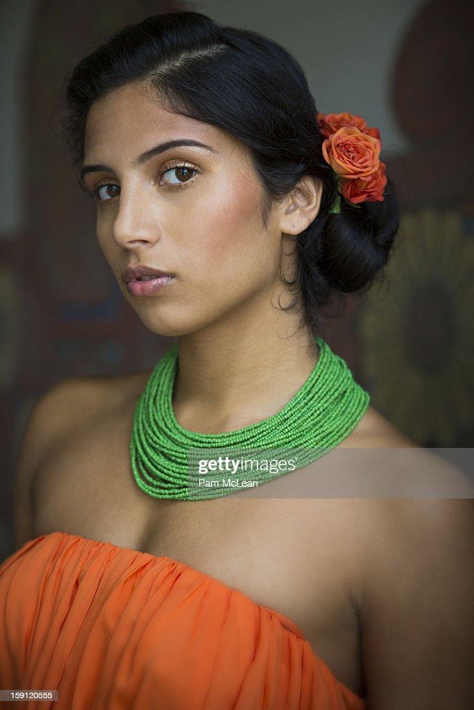 Portrait of ethnic woman in orange dress : Stock Photo