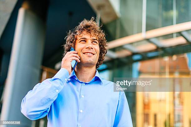 Portrait of European businessman with smartphone