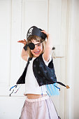 Portrait of excited little girl dressed up as a pirate
