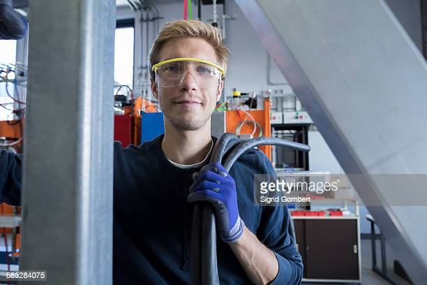 Portrait of factory technician with cabling