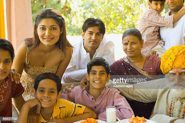 Portrait of family at table together
