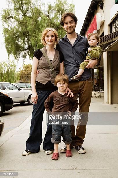 Portrait of family on city sidewalk