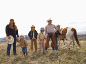 Montana family with horse on their ranch in Big Timber, Montana