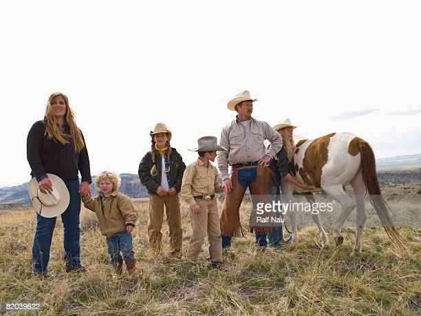 Portrait of family on horse ranch