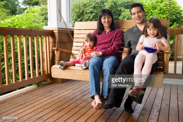 Portrait of family on porch swing