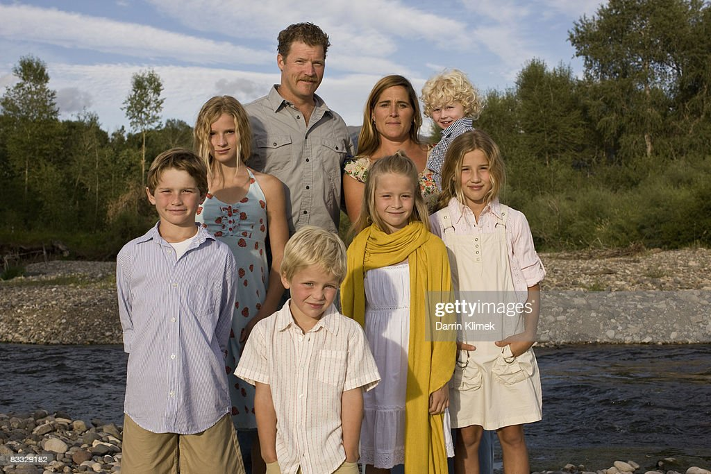 Portrait of family standing by river : Stock Photo