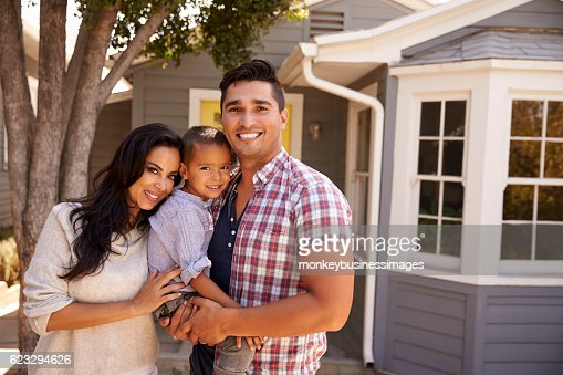 Portrait Of Family Standing Outside Home : Stock Photo