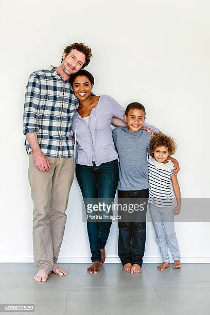 Portrait of family standing together at home