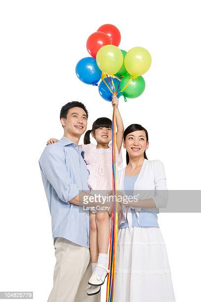 Portrait of family with balloons