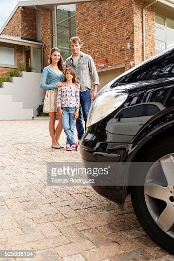 Portrait of family with teenage girl (13-15) standing next to house : Bildbanksbilder
