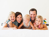 Portrait of family with three kids (6-7, 2-3, 6-11 months)
