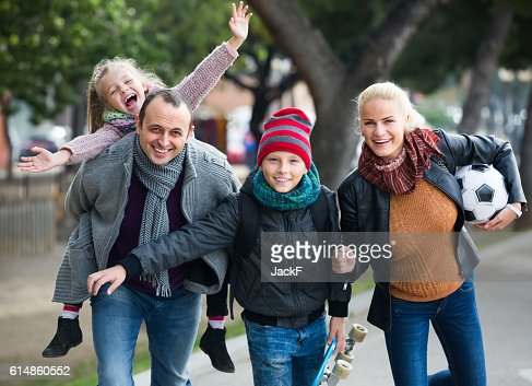 Portrait of family with two kids outdoors : Stock Photo