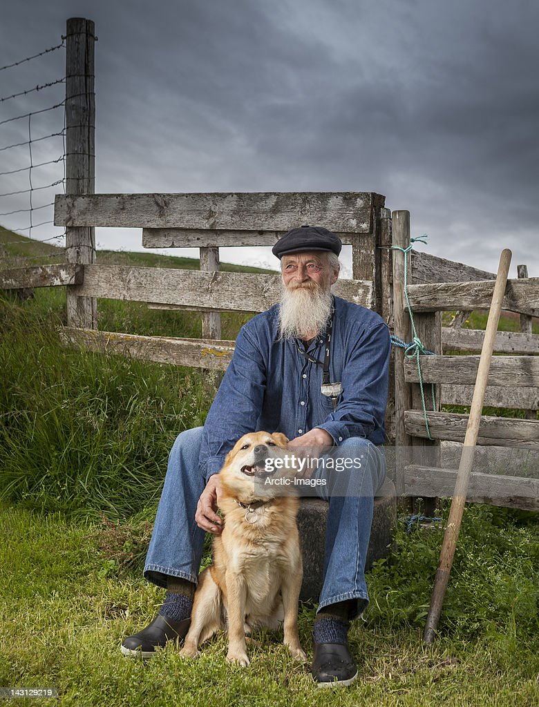 Portrait of farmer and his dog : Stock Photo