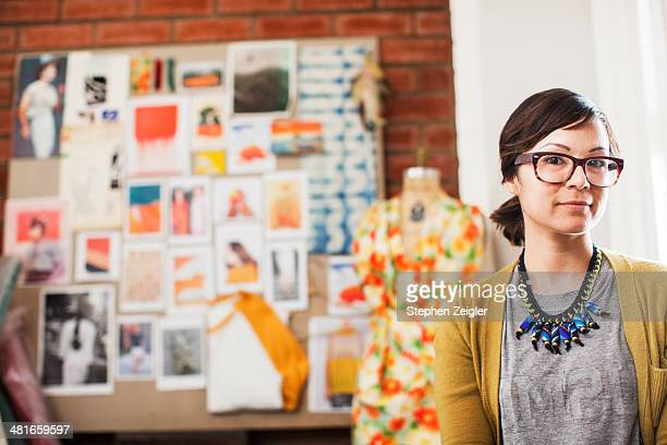 Portrait of fashion designer in her studio