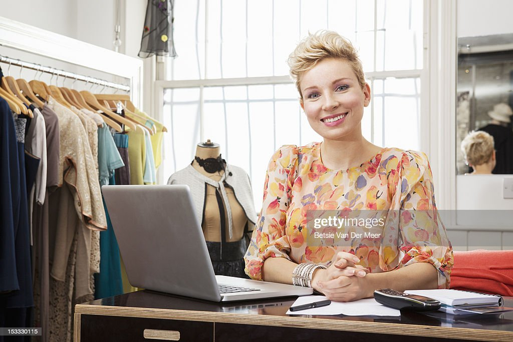 Portrait of fashion designer in studio. : Stock Photo