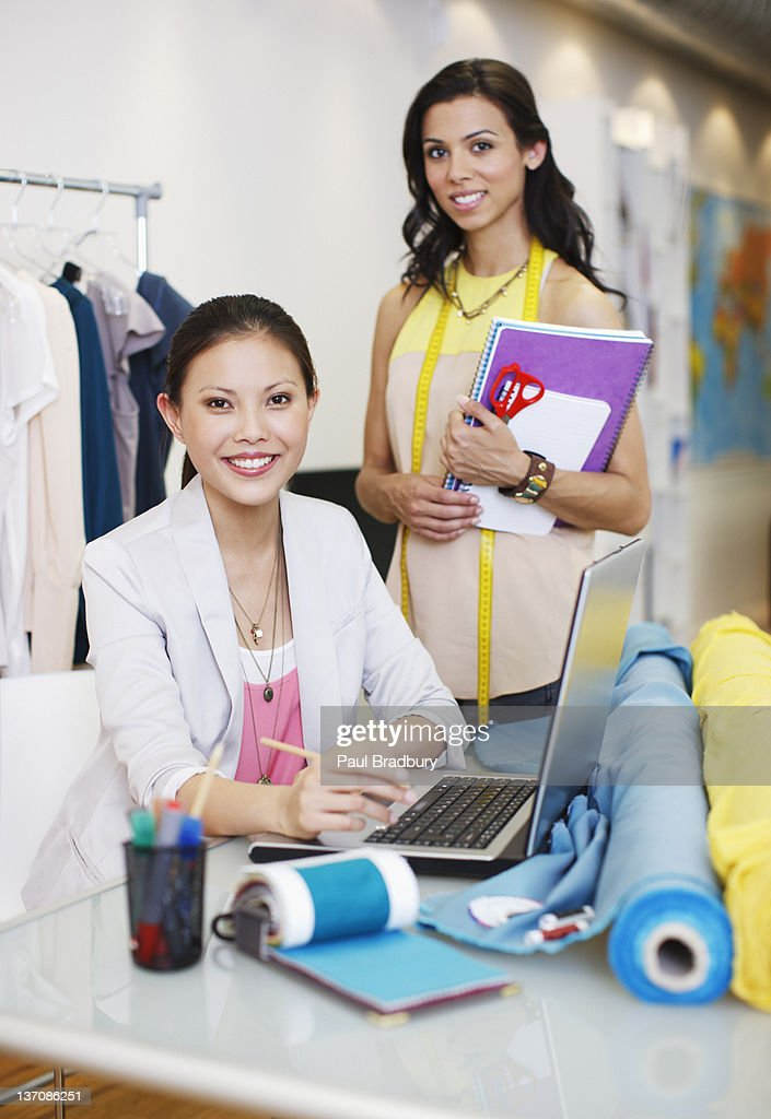 Portrait of fashion designers in office : Stock Photo