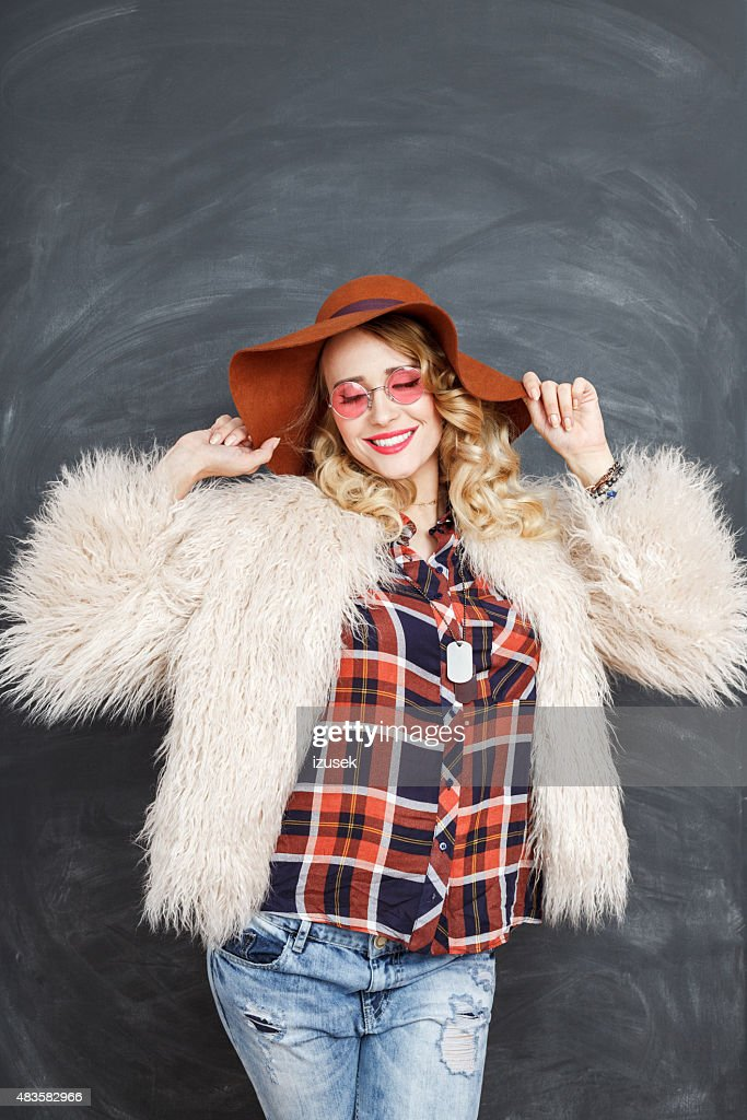 Portrait of fashionable blonde woman in boho style