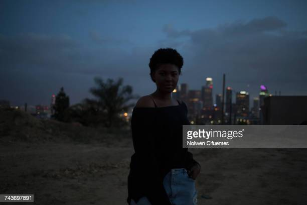Portrait of fashionable woman standing at beach against sky, Los Angeles, California, USA