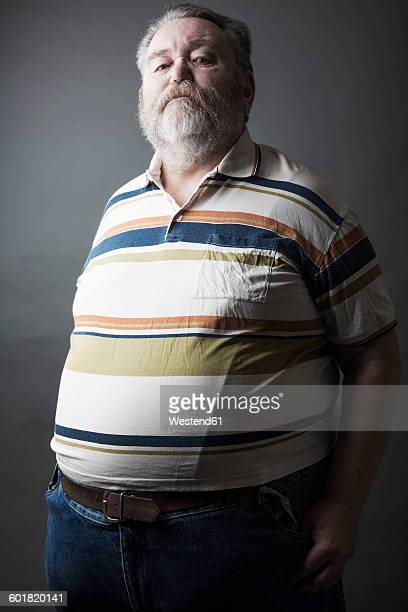 Portrait of fat senior man with full beard