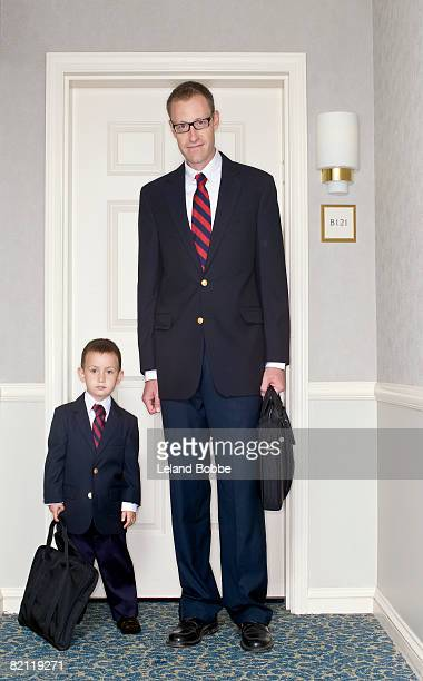 portrait of father and son at front door