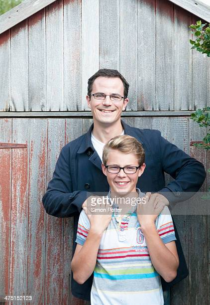 Portrait of father and teenage son in garden