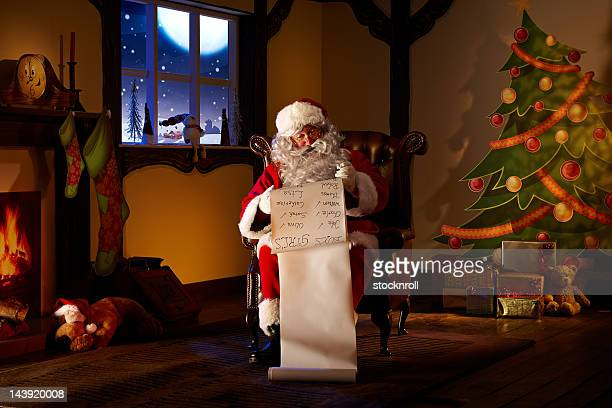 Portrait of Father Christmas checking his list