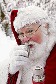 Portrait of Father Christmas Drinking From a Vacuum Flask