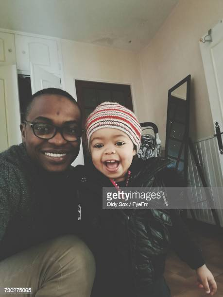 Portrait Of Father With Baby Boy At Home