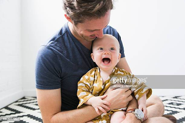 Portrait of father with baby son (2-5 months)