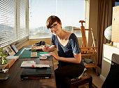 Portrait of female artist working at studio